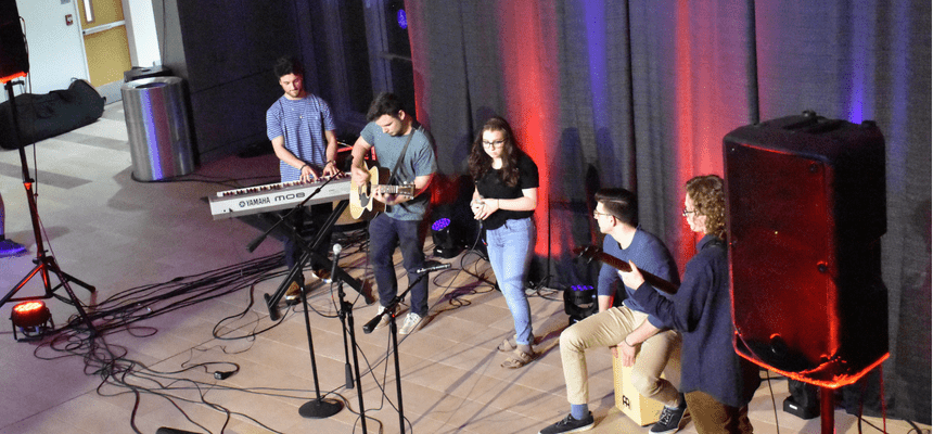 Student band performing in global heritage hall
