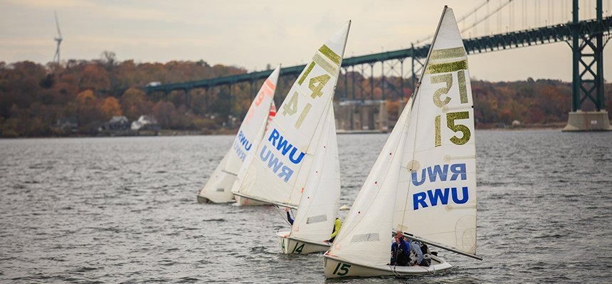 Sailing team practicing on RWU waterfront.