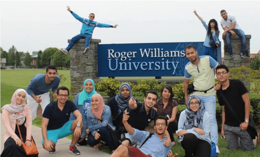 Middle East Partnership Initiative students engage with the RWU campus sign